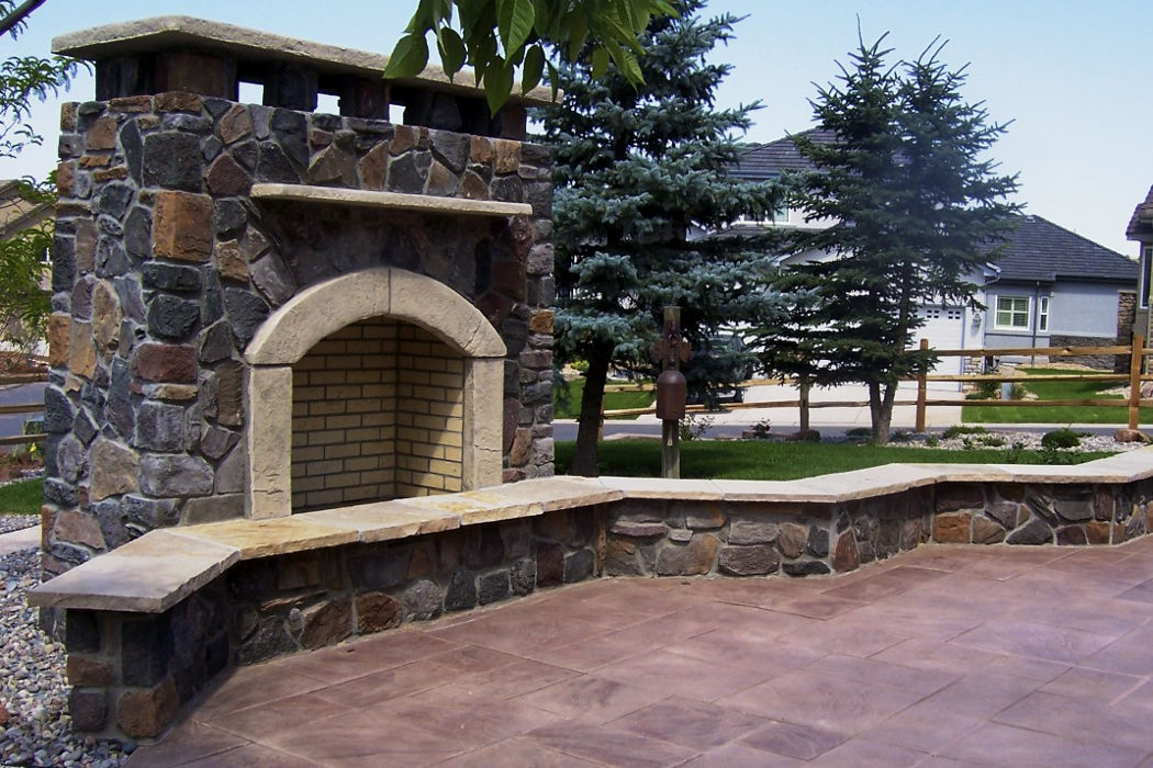 Outdoor stone fireplace, seating, and patio
